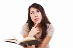 Serious young female with book Royalty Free Stock Photo