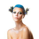 Serious young girl with short blue hairstyle and multicolor make Stock Images