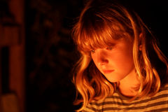 Serious Young Redhead Girl Watching Camp Fire. Girl Mesmerised By Light From Fire Stock Photos