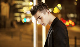 Serious young guy in the middle of the night Royalty Free Stock Photos