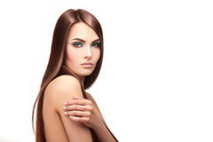 Serious young lady with healthy skin and perfcet straight hairst Royalty Free Stock Photo