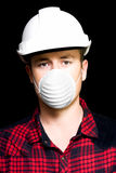 Serious young male artisan wearing protective mask Stock Photography