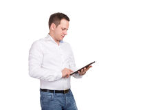 Serious young male executive using digital tablet against white background Royalty Free Stock Photos