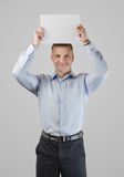 Serious young man with a banner Royalty Free Stock Photo