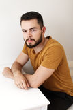 Serious young man with a beard Stock Photography