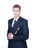 Serious young man with Bible Royalty Free Stock Photo