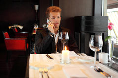 Man at restaurant talking on the phone Royalty Free Stock Photo