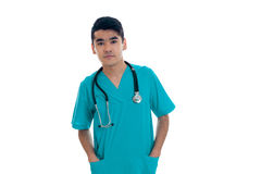 Serious young man doctor in blue uniform with stethoscop on his neck posing and looking at the camera isolated on white.  Stock Images