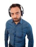 Serious young man with headphones Royalty Free Stock Photos