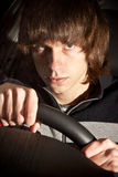 serious young man holding steering wheel on drivers seat Royalty Free Stock Image