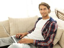 Serious young man with laptop. Royalty Free Stock Photo