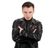 Serious young man in leather jacket Stock Photography