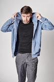 Serious young man with light beard in blue hoodie Stock Photography