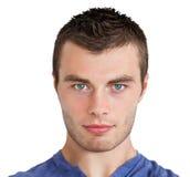 Serious young man looking at camera Stock Images
