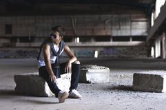 Serious young man in an old stadium Royalty Free Stock Photo