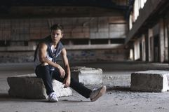 Serious young man in an old stadium Royalty Free Stock Photography