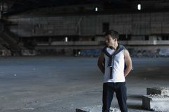 Serious young man in an old stadium Stock Photo