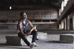 Serious young man in an old stadium Royalty Free Stock Photos