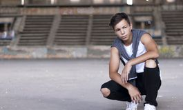 Serious young man in an old stadium Royalty Free Stock Image