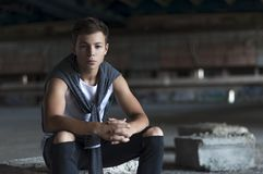 Serious young man in an old stadium Stock Photography