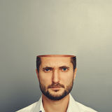 Serious young man with open head Royalty Free Stock Images
