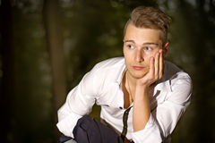 Serious young man outdoors in park at night Stock Photography