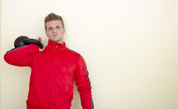 Serious young man (personal trainer or athlete) in tracksuit Royalty Free Stock Photos
