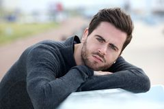 Serious young man posing outdoors Royalty Free Stock Photography