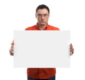 Serious young man showing and displaying placard Stock Image