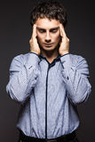 Serious young man in  striped shirt with Royalty Free Stock Images