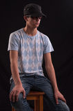 Serious young man with sunglasses and baseball hat, si Stock Photos