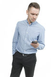 Serious young man talking on mobile isolated on white background royalty free stock images