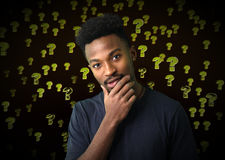 Serious young man thinking doubt expression question mark background Stock Image
