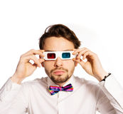Serious young man wearing 3d glasses Royalty Free Stock Photo