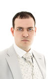 Serious young man in wedding suit portrait Stock Image