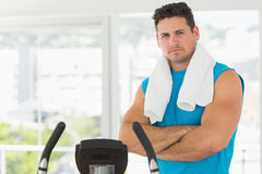 Serious young man working out at spinning class Royalty Free Stock Photos