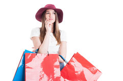 Serious young model at shopping looking pensive Stock Photography