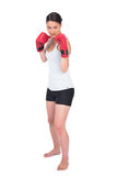 Serious young model in sportswear boxing Royalty Free Stock Photo