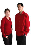 Serious young people. Young couple in red with serious expressions; isolated on white Stock Photos