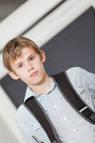 Serious young school boy in a tilted angle view Royalty Free Stock Photo