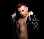Serious young shirtless man in leather jacket Royalty Free Stock Photography