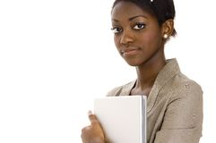 Serious Young Woman. A serious young black woman in suit holding laptop Royalty Free Stock Image