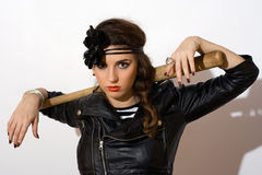 Serious young woman with a bat Royalty Free Stock Images