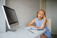 Serious young woman in blue dress have headache stock images
