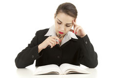 Serious young woman with book Royalty Free Stock Photo
