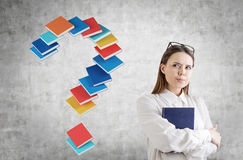 Serious young woman with a book, question mark Royalty Free Stock Photography