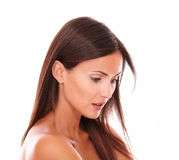 Serious young woman with brown hair looking down Royalty Free Stock Photo