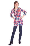 Serious young woman in check shirt Stock Photos