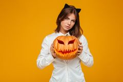 Serious young woman dressed in crazy cat halloween costume Royalty Free Stock Photography