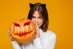 Serious young woman dressed in crazy cat halloween costume Stock Photos